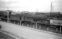 Robinson Ex-GCR D11 <I>Director</I> 4-4-0 no 62666 <I>Zeebrugge</I> (centre) with 62670 <I>Marne</I> to the right, standing at Darnall shed, Sheffield in April 1960. Both locomotives were withdrawn towards the end of that year and subsequently cut up at Doncaster Works. The 10-road steam shed at Darnall eventually closed in 1963. After use as a wagon repair depot for several years it fell into disuse and was finally demolished in 1995.<br> <br><br>[Robin Barbour Collection (Courtesy Bruce McCartney)&nbsp;10/04/1960]