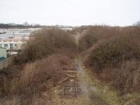 <I>End of the line</I>. The disused former Fleetwood line peters out about one mile north of Burn Naze and this view towards Wyre Dock and Fleetwood shows the last few yards of track, finally used by coal trains to Fleetwood Power Station in the 1980s. Long demolished Fleetwood steam shed was in the middle distance on the left hand side of the line. Photo taken from an overbridge at Map Ref <br> SD 329455. <br><br>[Mark Bartlett&nbsp;17/02/2009]