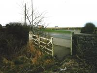 Looking towards the former station at Elliot Junction in March 1999. View is over the site of the level crossing at the start of the Carmyllie branch.<br><br>[David Panton&nbsp;15/03/1999]