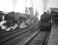 A touch of steam! South end of Carlisle in December 1963 with Black 5 no 45478 having brought an Edinburgh - Birmingham train into platform 4 alongside a pair of Coronation Pacifics standing on the centre road. The Pacifics are 46240 <I>City of Coventry</I>, which will relieve the Black 5 and 46237 <I>City of Bristol</I> waiting to take over the up <I>Royal Scot</I>.<br><br>[Robin Barbour Collection (Courtesy Bruce McCartney)&nbsp;28/12/1963]