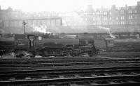 View south across the ECML at St Margarets shed in February 1965 with the usual haze hanging over London Road. 64A residents on shed that day included Standard Class 4 2-6-4T 80022 and B1 4-6-0 61099 in the right background alongside the coaling stage. <br><br>[K A Gray&nbsp;06/02/1965]