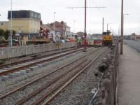 The Blackpool and Fleetwood tramway relaying is currently (Feb 09)concentrated on the reserved section between the two carriageways in Cleveleys. This view is south towards Blackpool and shows the contractor's rail mounted crane with new track in evidence. <br><br>[Mark Bartlett&nbsp;17/02/2009]