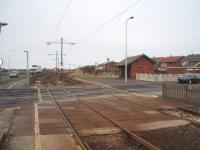 It is unusual to see rusty tracks on the tramway to Fleetwood but this section was closed during winter 2008/09 for refurbishment, including track renewal. Rossall School halt is the point where the tramway swings away from the roadside to cross the peninsula and then join the main street through Fleetwood town centre. View north towards Fleetwood.<br>  [See image 44214]<br><br>[Mark Bartlett&nbsp;17/02/2009]