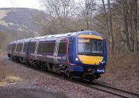 170 418 forms the 1159 Perth-Edinburgh service, just south of Lindores Loch on the Hilton Junction-Ladybank line<br><br>[Bill Roberton&nbsp;20/02/2009]