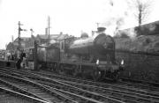 D34 4-4-0 no 256 <I>Glen Douglas</I> taking water at the west end of Alloa on 30 March 1964 with <i>Scottish Rambler No 3</i>. The train will leave shortly for the next leg of the railtour, heading for Larbert via Alloa Swing Bridge.<br><br>[K A Gray&nbsp;30/03/1964]