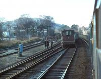 <I>Oops - and not an orange jacket in sight</I>. Brush Class 47, 47463, heading for Holyhead with a passenger train, creeps gingerly past a derailed brake van and coal trucks at Colwyn Bay. My records show the loco in charge of the freight was a Class 40, 40031, the former <I>Sylvania</I>, which was withdrawn two months later. The Class 47 lasted a further 14 years and both were dismantled in Crewe Works.<br><br>[Mark Bartlett&nbsp;15/03/1981]
