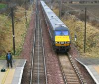 <I>Waiting for Tornado</I>... a photographer with an interesting dual-camera rig awaits the arrival of 60163 with the <I>Auld Reekie Express</I> at Wallyford on 28 February 2009. Meantime an ECML service to Kings Cross is about to run through the station on the up line.<br><br>[John Furnevel&nbsp;28/02/2009]
