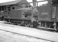 Reid N15 0-6-2T locomotives 69182 and 69146 at Eastfield shed c.1959. Note the wire and pulley attachment on the former, used to release the slip-coupling after banking trains out of Queen Street up the 1 in 45 Cowlairs Incline. <br> <br><br>[K A Gray&nbsp;//1959]