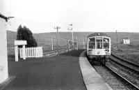 The evening Carlisle - Hawick stopping service arrives at Riccarton Junction in 1968. The bay platform to the left was originally used by trains off the Border Counties Line from Hexham. Riccarton south box stands in the background.<br><br>[Bruce McCartney&nbsp;//1968]