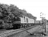 EE Type 4 no D335 heads north approaching Penrith at Eamont Bridge Junction in September 1967 hauling a partially-fitted mineral train.<br> <br><br>[Colin Miller&nbsp;25/09/1967]