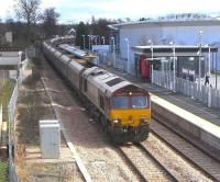 EWS 66004 passes through Alloa on its way back to Hunterston on 4 March 2009 with Longannet empties, dwarfing the 3-car 170 at the station platform forming the next service to Glasgow Queen Street.<br><br>[David Panton&nbsp;04/03/2009]