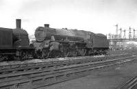 Of the 842 Stanier Black 5s built, only five carried a name during their normal operational service. One of these, no 45157 <I>The Glasgow Highlander</I>, stands at Stirling South shed c. 1958.<br> <br><br>[K A Gray&nbsp;//1958]