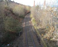 Site of the former Leith Walk station looking north west on 28 February 2009, over platforms substantially extant 79 years after closure, although some trouble has been taken to centre the remaining line, which now runs as far as the Edinburgh Council refuse depot at Powderhall.<br><br>[David Panton&nbsp;28/02/2009]