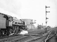 BR Standard Class 6 Pacific no 72006 <I>Clan MacKenzie</I>, at the head of a southbound freight, is held at Stirling in April 1965. <br><br>[Robin Barbour Collection (Courtesy Bruce McCartney)&nbsp;16/04/1965]
