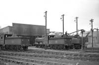 Bathgate shed hosts a pair of J36 0-6-0s, nos 65267 (left) and 65282 on 16 April 1965. The locomotive on the right is 76104. View north across the running lines. [See image 25412] <br><br>[Robin Barbour Collection (Courtesy Bruce McCartney)&nbsp;16/04/1965]