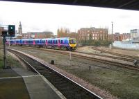 185149 arrives at Bolton station on 05 March 2009 from the Preston direction with a service to Manchester Airport. The tracks curving away to the right come together around the corner and form the single track route to Blackburn.<br><br>[John McIntyre 05/03/2009]