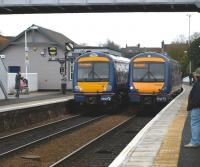 170404 on the right, calls at Inverkeithing after a refit at Babcock Engineering Services, Rosyth Dockyard (see image 22278). New lighting is evident, however the unit has been involved in a <I>rough shunt</I>.<br><br>[Brian Forbes&nbsp;09/03/2009]