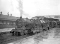 A pair of Hurlford shed's Fowler 2P 4-4-0s nos 40661 and 40689 wait with their trains in the bays at the north end of Kilmarnock station circa 1959. On the left is the 4.16pm to Glasgow St Enoch and on the right the 4.13pm to Ayr.  Both locomotives had been withdrawn by the end of 1960.<br><br>[Robin Barbour Collection (Courtesy Bruce McCartney)&nbsp;27/03/1959]