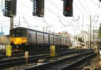 150143, with a class 156 unit leading the 4-car formation, runs into Preston station from the south on 1 March 2009.<br><br>[John McIntyre&nbsp;01/03/2009]