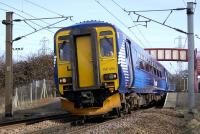 Saltire liveried 156 494 leaves Curriehill with an Edinburgh Waverley - Glasgow Central service on 13 March.<br><br>[Bill Roberton&nbsp;13/03/2009]