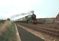 4472 <I>Flying Scotsman</I> with twin tenders attached approaching Scemerston, Northumberland, with a special in the late 1960s.<br><br>[Bruce McCartney&nbsp;//]