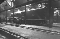 A4 Pacific 60024 <I>Kingfisher</I> receives visitors in the gloom of Ferryhill shed on 3 September 1966 as Type 2 diesel D5307 looks on in the background. The official BR withdrawal date for 60024 was 5 September 1966, two days after this photograph was taken. <br><br>[Colin Miller&nbsp;03/09/1966]