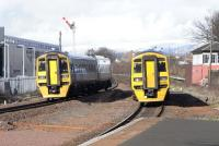 Two English exiles pass at Larbert North box on 4 March: 158 871 in Alphaline silver livery heads for Dunblane and while ex-SWT 158 786 approaches Larbert station with an Edinburgh service. The semaphore is in odd but pleasing contrast with the swish Network Rail Training School to the left. Last year semaphores gave way to LED MAS to the south at Larbert Junction and at Plean Junction to the north, where the very tall box (image 19254) is now demolished. There are LN (Larbert North) plates on the signals on their former patch.<br><br>[David Panton&nbsp;04/03/2009]