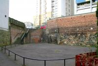 On leaving North Leith, the EL&N line entered a tunnel running under Coburg Street, emerging alongside the Water of Leith and the first stop at Junction Bridge (renamed from Junction Road in 1923). The north end of the tunnel, seen here from the station site in March 2009, has been bricked up and a play area formed, with stone steps now installed to provide a link across to Coburg Street.     <br> <br><br>[John Furnevel&nbsp;15/03/2009]