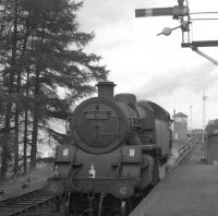 80028 on duty on the Killin branch train runs round at Killin Junction in 1965. The branch line turns off just before the signal box in the background with the Callander & Oban main line running straight ahead towards Glen Ogle. <br><br>[K A Gray&nbsp;//1965]