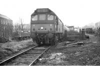 Shunting at Galashiels in March 1969 when the line was freight-only. The white plaque on the locomotive says EURS (Edinburgh University Railway Society). The Society was making use of this particular working to run an attached brake van trip.<br> <br><br>[Bruce McCartney&nbsp;/03/1969]