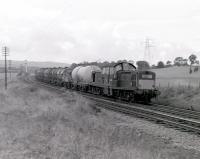 Glasgow-bound oil train passing Crookston circa 1966, with a Clayton having replaced the usual Black 5. [See image 19728]<br><br>[Colin Miller //1966]