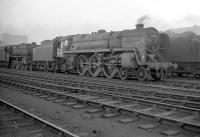 72005 <I>Clan MacGregor</I> stands outside Kingmoor shed in the 1960s. Withdrawn from 12A in May 1965, the locomotive was cut up at Arnott Young, Troon, two months later. <br><br>[Robin Barbour Collection (Courtesy Bruce McCartney)&nbsp;//]