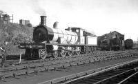 Prior to closure in 1964, Dawsholm shed played host to a number of historic locomotives used on the railtour circuit. Examples seen here in  1959 include the Jones Goods and Glen Douglas, both being cleaned, presumably in preparation for duties connected with the 1959 Scottish Industries Exhibition.<br><br>[K A Gray&nbsp;/09/1959]