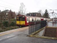 A Newton to Glasgow (via the Outer Circle) train, formed by 314209, pauses by the distinctive entrance to Langside's elevated island platform. <br><br>[Mark Bartlett&nbsp;26/02/2009]