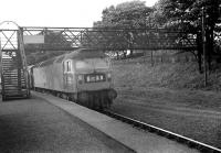 Brush Type 4 no 1968 with a southbound Edinburgh - Birmingham service passing through Riccarton Junction in 1968. The train will rejoin the WCML at Carlisle, having been diverted from its normal route via Carstairs due to engineering activity. <br> <br><br>[Bruce McCartney&nbsp;//1968]