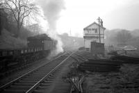 Q6 63379 clatters past Beamish signal box on a misty morning in February 1964 with a train of flats heading for Consett steelworks.<br><br>[Robin Barbour Collection (Courtesy Bruce McCartney)&nbsp;15/02/1964]