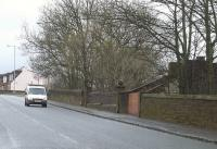 Main Road in Elderslie looking west in March 2009. On the right stand the bricked up remains of the entrance to Elderslie station, which was closed in 1966. <br><br>[Graham Morgan&nbsp;03/03/2009]