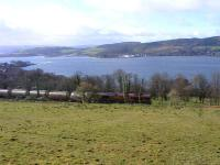 EWS 66103 with a freight above the Gareloch between Rhu and Shandon in March 2009, as tree felling improves the views.<br><br>[John Robin&nbsp;25/03/2009]