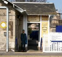 Nostalgic paraphernalia surrounding the north side exit from Prestonpans station on 21 March 2009. The <I>railwayman</I> figure looks like an interesting addition.... although I couldn't help wondering how it might go down with the lone passenger off the last train on a dark winter's night hurrying along the platform and turning towards the exit steps.... creepy  <br> <br><br>[John Furnevel&nbsp;/03/2009]