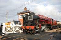 <I>Royal Scot</I> on the level crossing at Blue Anchor station on 25 March 2009.<br><br>[Peter Todd&nbsp;25/03/2009]