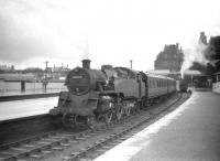 BR Standard class 4 no 80025 off Corkerhill shed prepares to take a train for Glasgow out of Ayr station on 28 July 1959.<br><br>[Robin Barbour Collection (Courtesy Bruce McCartney)&nbsp;28/07/1959]