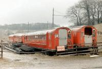 Withdrawn Glasgow Subway stock at Beamish in 1979. The six redundant units had been obtained 2 years previously and were intended for use by the museum in the construction of replica tramcars. What eventually happened to the idea,... or the cars themselves, is not known.<br><br>[Colin Miller&nbsp;//1979]