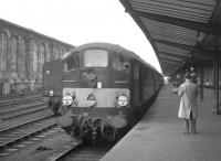 One of the 1200hp Co-Bo diesel locomotives, D5701, built by Metropolitan Vickers in 1958 as part of the <I>BR modernisation plan</I>, stands at Carlisle with a southbound train in the 1960s. Notoriously unreliable machines, of the 20 examples in the class, 19 had disappeared by December 1969 (8 to McWilliams, Shettleston and 11 to Cashmores, Great Bridge) with the remaining example now preserved on the East Lancs Railway [see image 18211]. <br><br>[K A Gray&nbsp;30/07/1966]