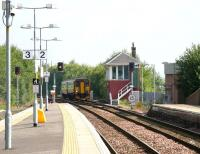 A Glasgow Central - Kilmarnock stopping service approaching platform 1 at Barrhead on 17 August 2006.<br><br>[John Furnevel&nbsp;/08/2006]