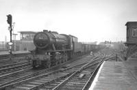 Ex-WD Austerity 90001 brings a train of coal empties south through Doncaster in April 1963.<br><br>[K A Gray&nbsp;11/04/1963]