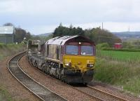 Having just passed the now extinct <i>Cawburn Jct</i> 66245 heads toward the site of Drumshoreland station with the empty <i>Bathgate Cars</i> to Washwood Heath on 13 April 2004<br><br>[James Young&nbsp;13/04/2004]