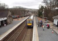 A Glasgow to Inverness service, formed by 170403, calls at Pitlochry in this view from the station footbridge looking south towards Dunkeld and Birnam.<br><br>[Mark Bartlett&nbsp;30/03/2009]