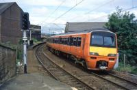 A Strathclyde Orange 320 enters Partick from the north in the mid 90s.<br><br>[Andy Kirkham&nbsp;//]