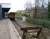 Looking like it hasn't been through the carriage cleaning plant at Kirkdale recently, Merseyrail EMU 507003 waits at Ormskirk with the next service to Liverpool Central on 30 March 2009. The old down platform (now out of use) retains its building, although no longer in railway use and with some alterations.<br> <br><br>[John McIntyre&nbsp;30/03/2009]