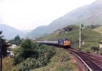 A class 37 with a train from Mallaig approaching Glenfinnan station in 1984. <br><br>[Andy Kirkham&nbsp;//1984]